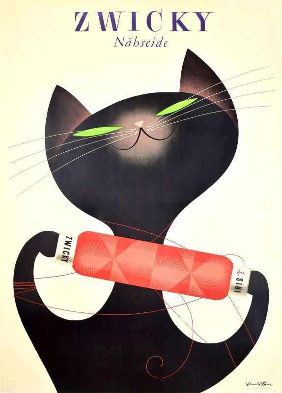 Cat plays with spool of yarn; white, black, red