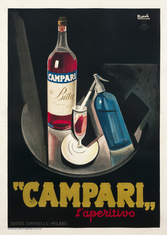 Still life with Campari bottle and seltzer bottle spraying into glass; black, red, blue, yellow