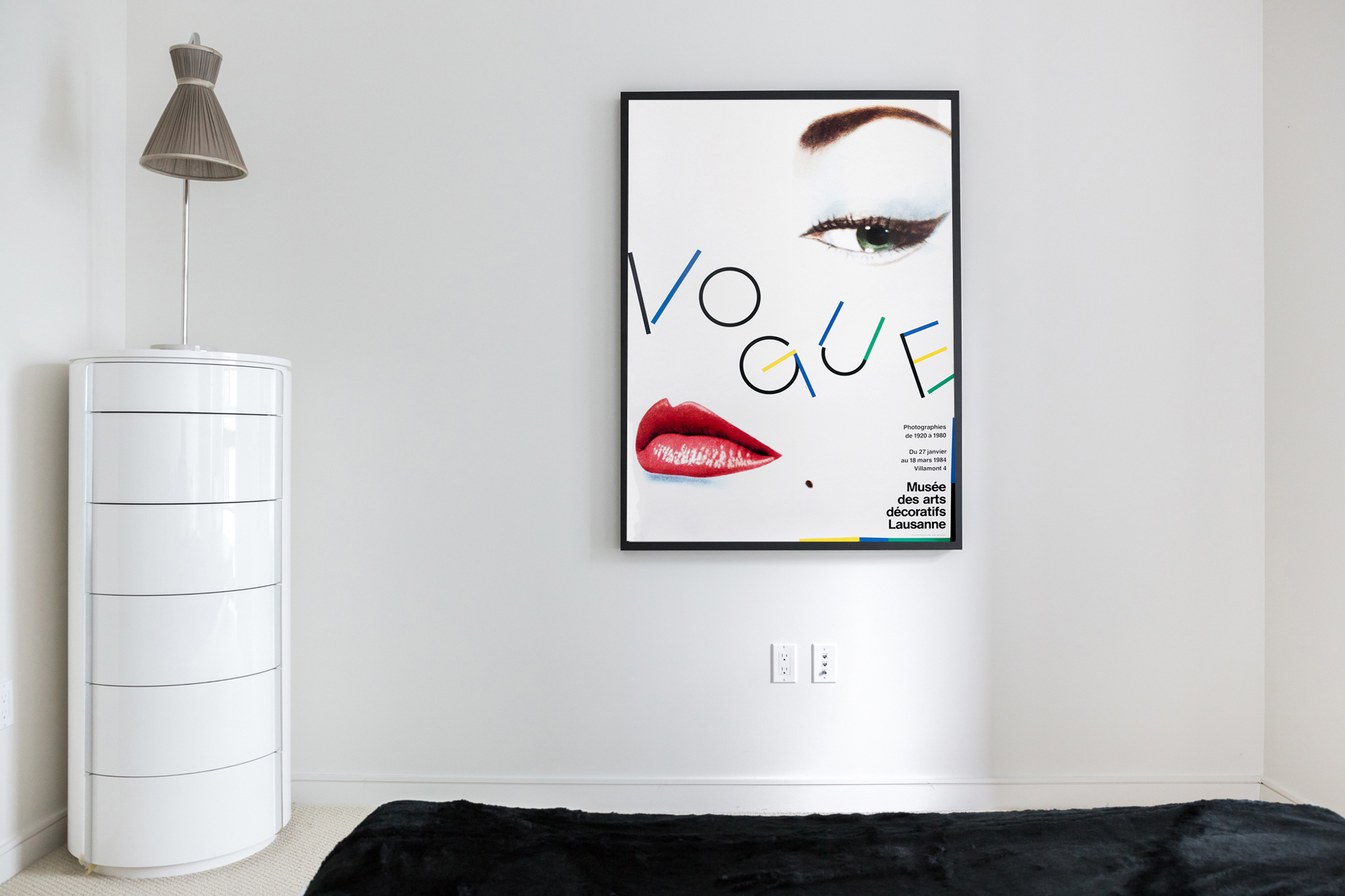 Typographic Vogue poster in minimalist room; red, white, blue, black