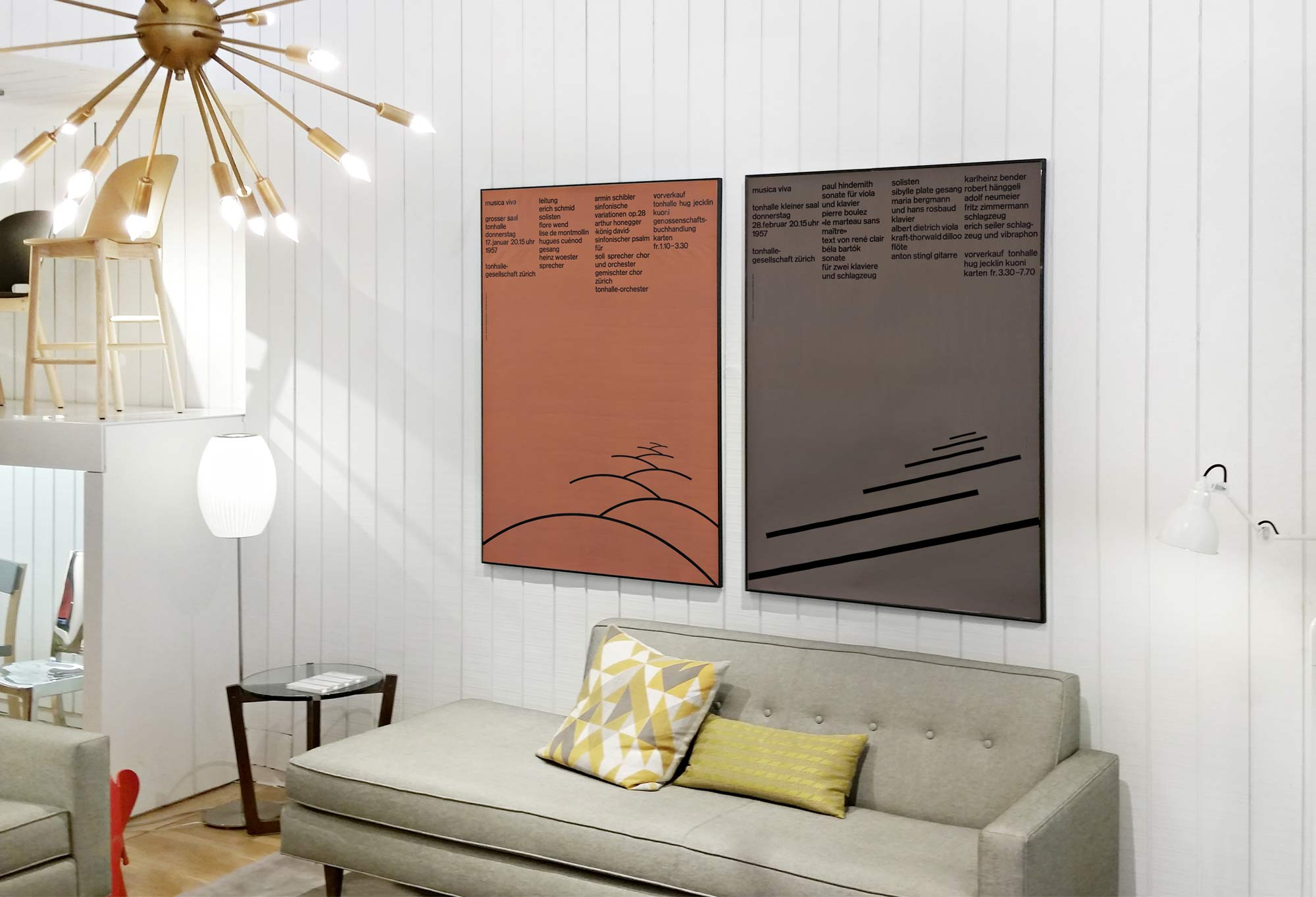 Typographic music posters in playful modern living space; brown, grey, yellow, white