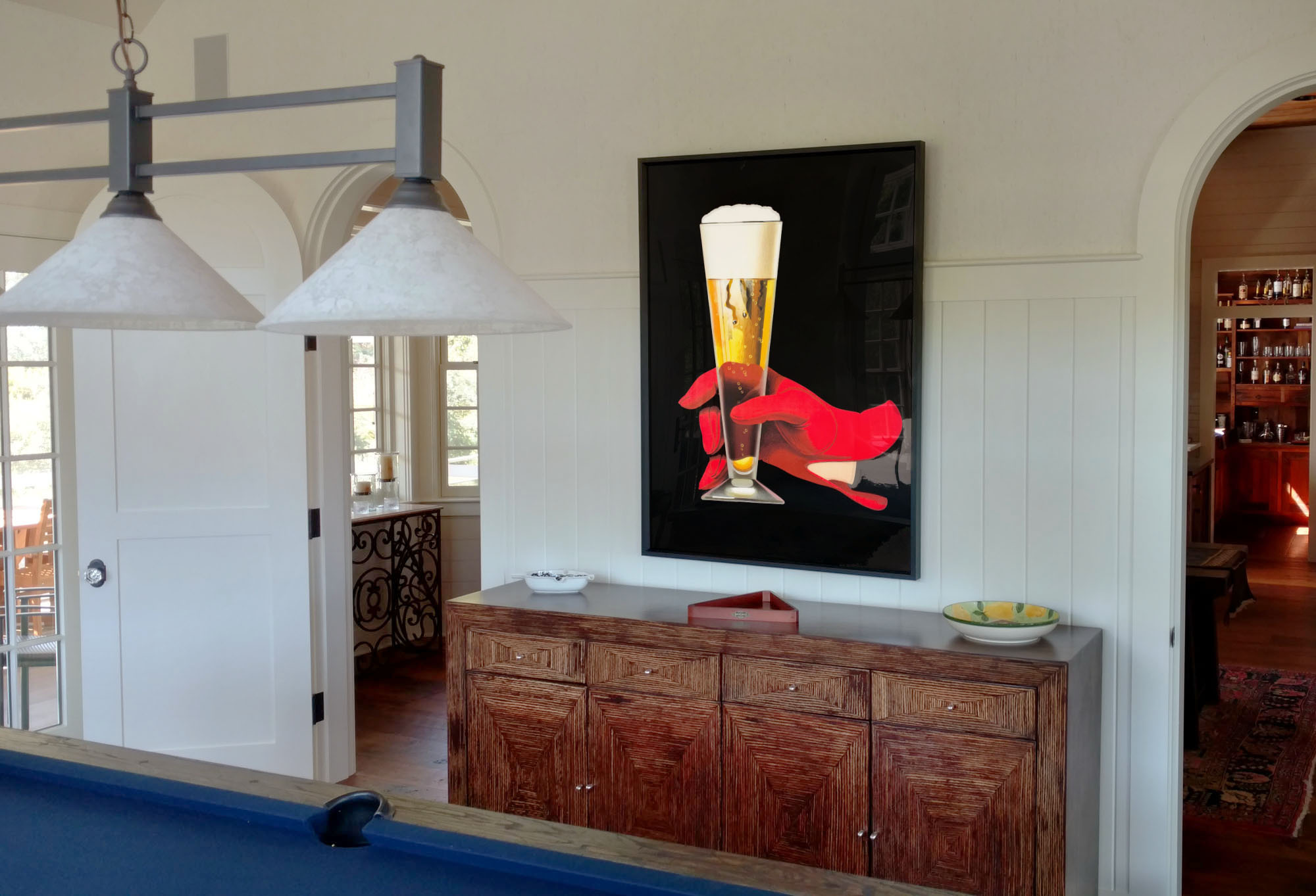 Dramatic beer poster in gloved hand in billiards room; brown, blue, red, white