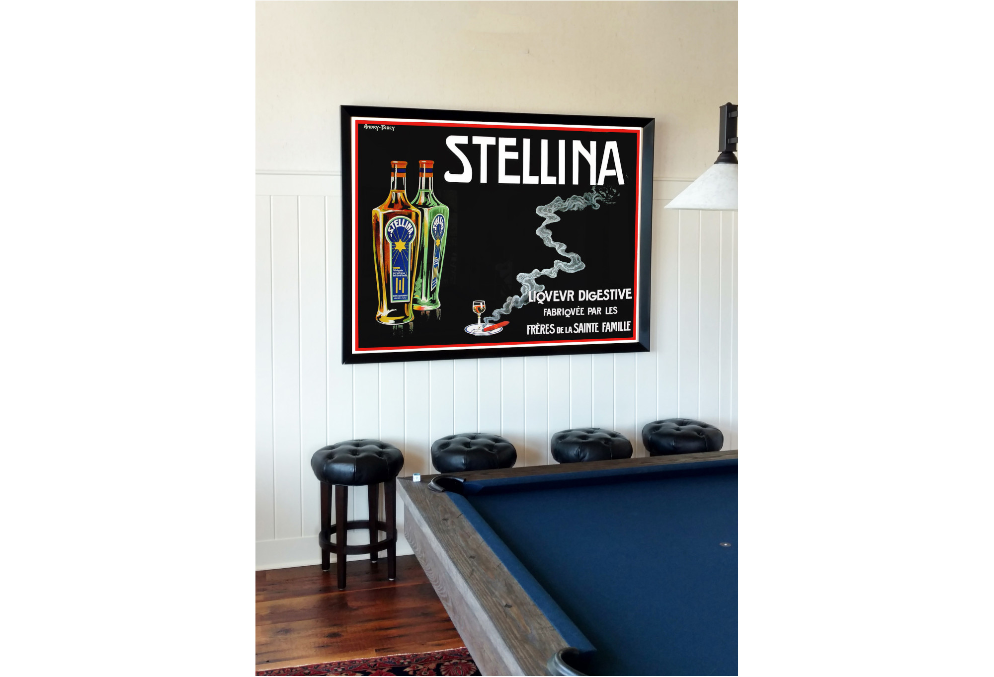 blue pool table with vintage liquor poster on wall; blue, white, green, red, yellow