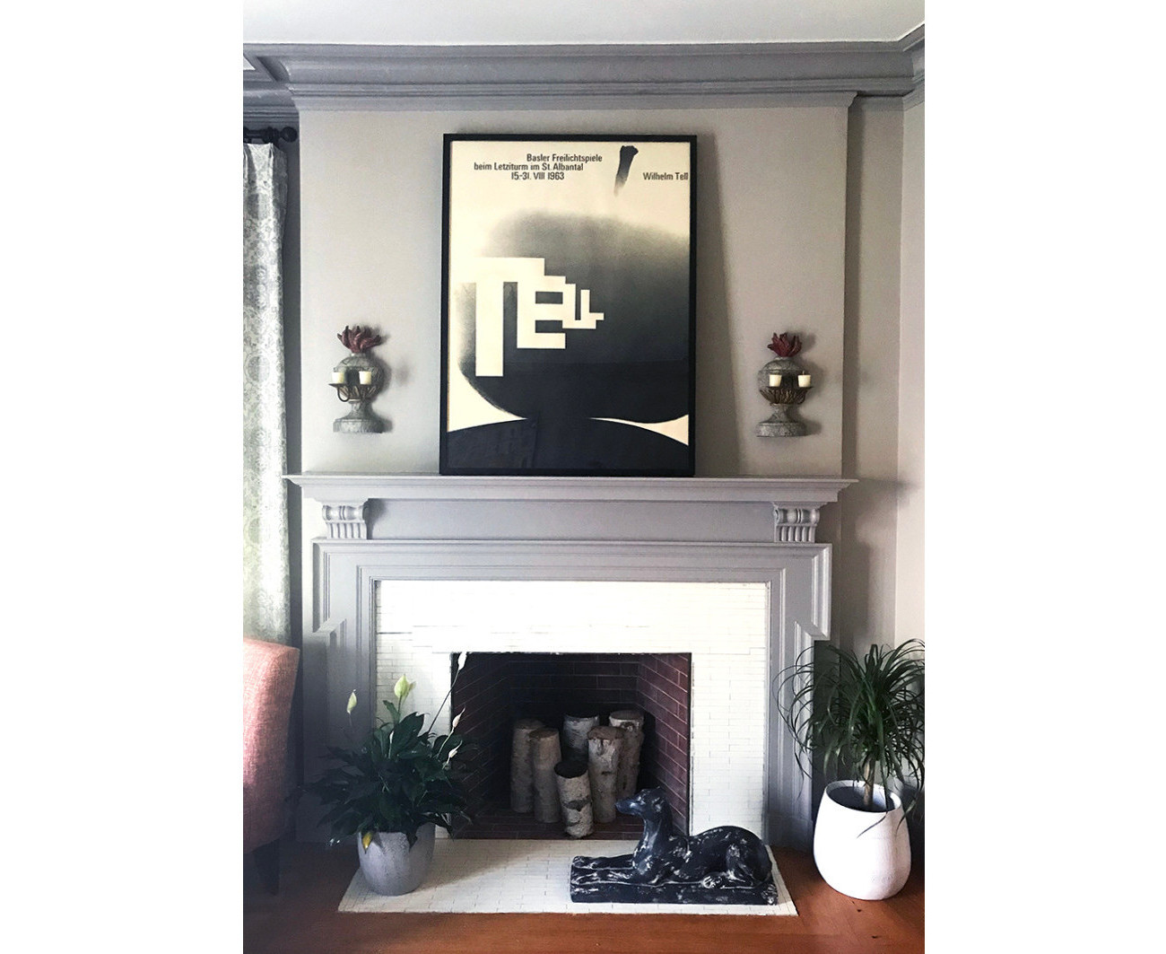 modern home fireplace with typographic poster above; black, white, gray