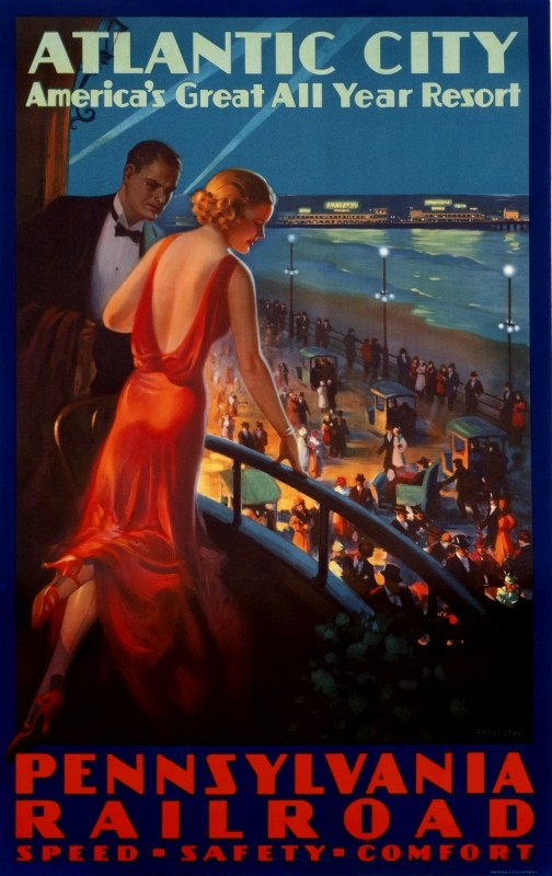 couple on balcony overlook the Boardwalk and beach at night; blue, red, green, beige