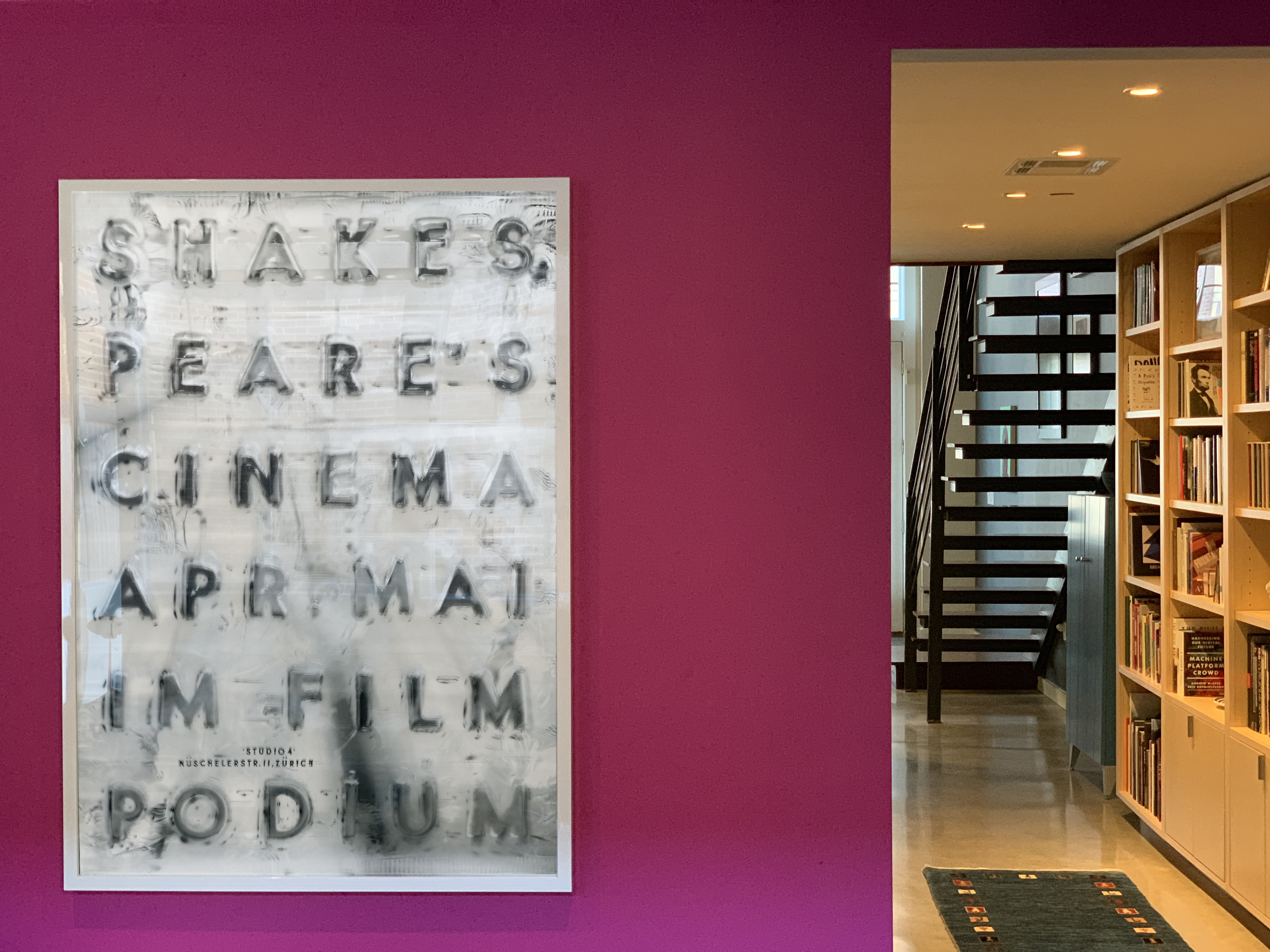 hallway with accent wall and Shakespeare Filmpodium poster; pink, white, black