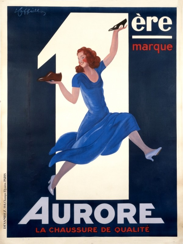 Woman holds up shoes in front of large number one 1; blue, white