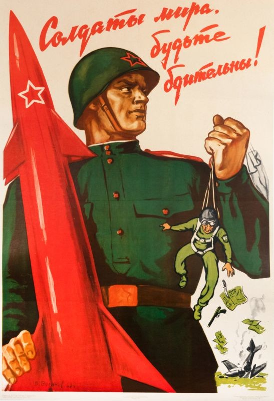 Soviet soldier with missile holds up downed pilot Gary Powers; red, greeen, black